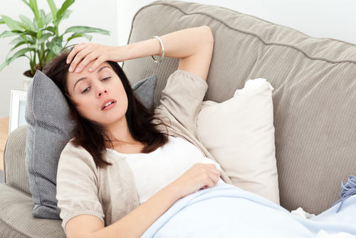 Woman detoxing on a couch at home