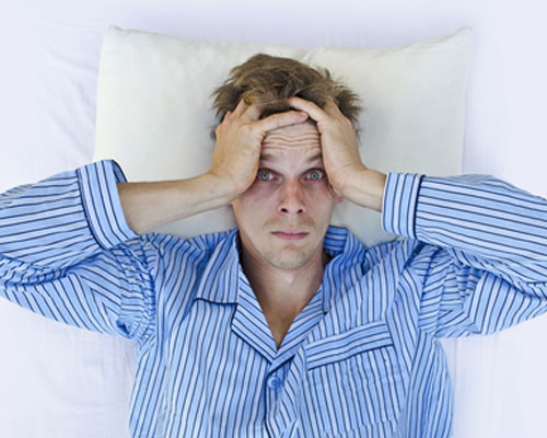 Man with insomnia because of MDMA lies awake in bed