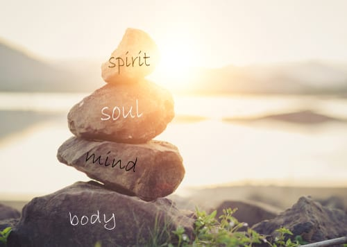 A pile of stones labelled mind, body, spirit, and soul