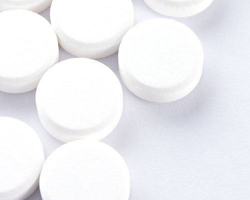 Pills against a white background