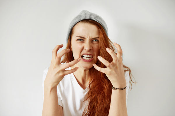 Angry woman experiencing mood swings from fentanyl withdrawal