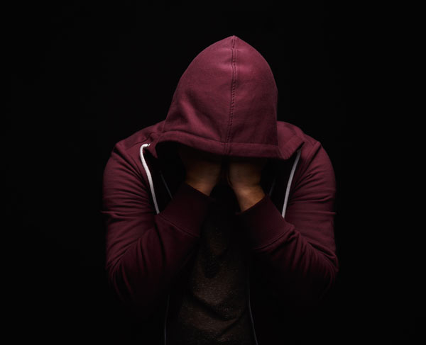 Young man in a hoodie suffering from Estazolam withdrawal