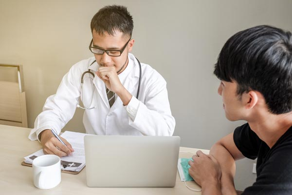 Doctor and client discussing addiction treatment financing