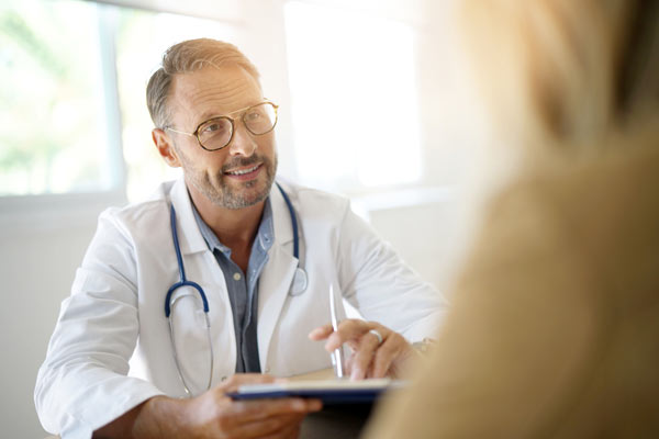 Doctor consulting a client about outpatient rehab