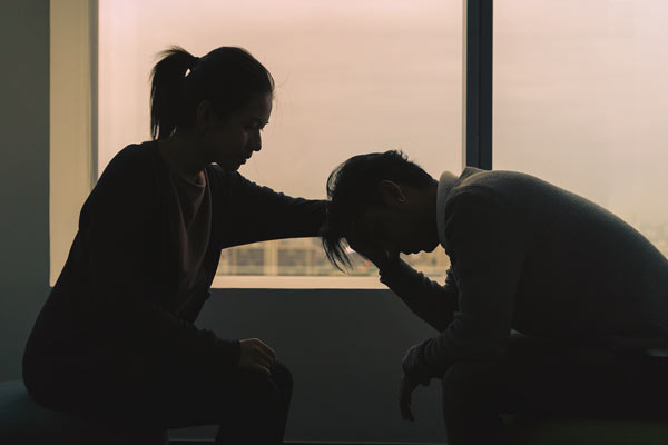 Couple lamenting their diseases induced by marijuana abuse