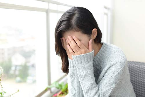 Sad woman suffering from Zimovane withdrawal